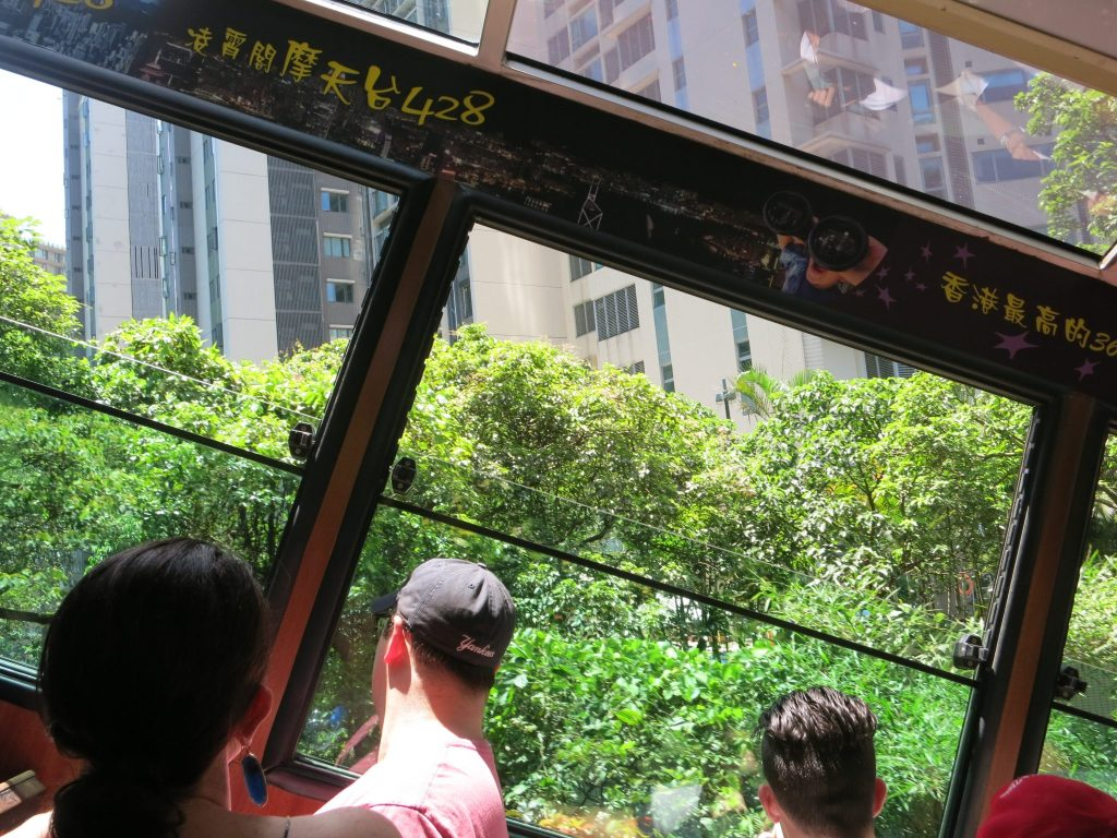buildings seen from the tram show how much the tram is tilted as it descends Victoria Peak