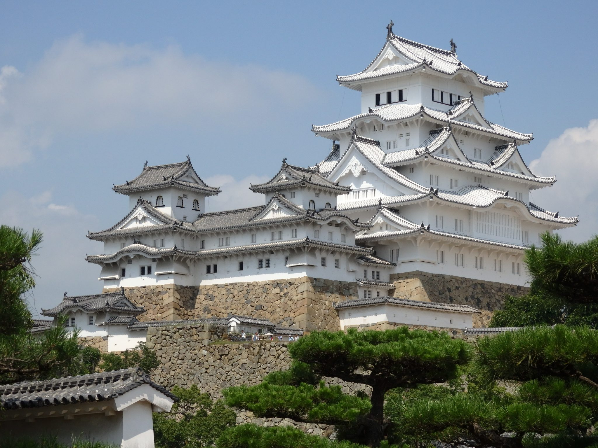 The ornate, enormous, white Himeji Castle looms.