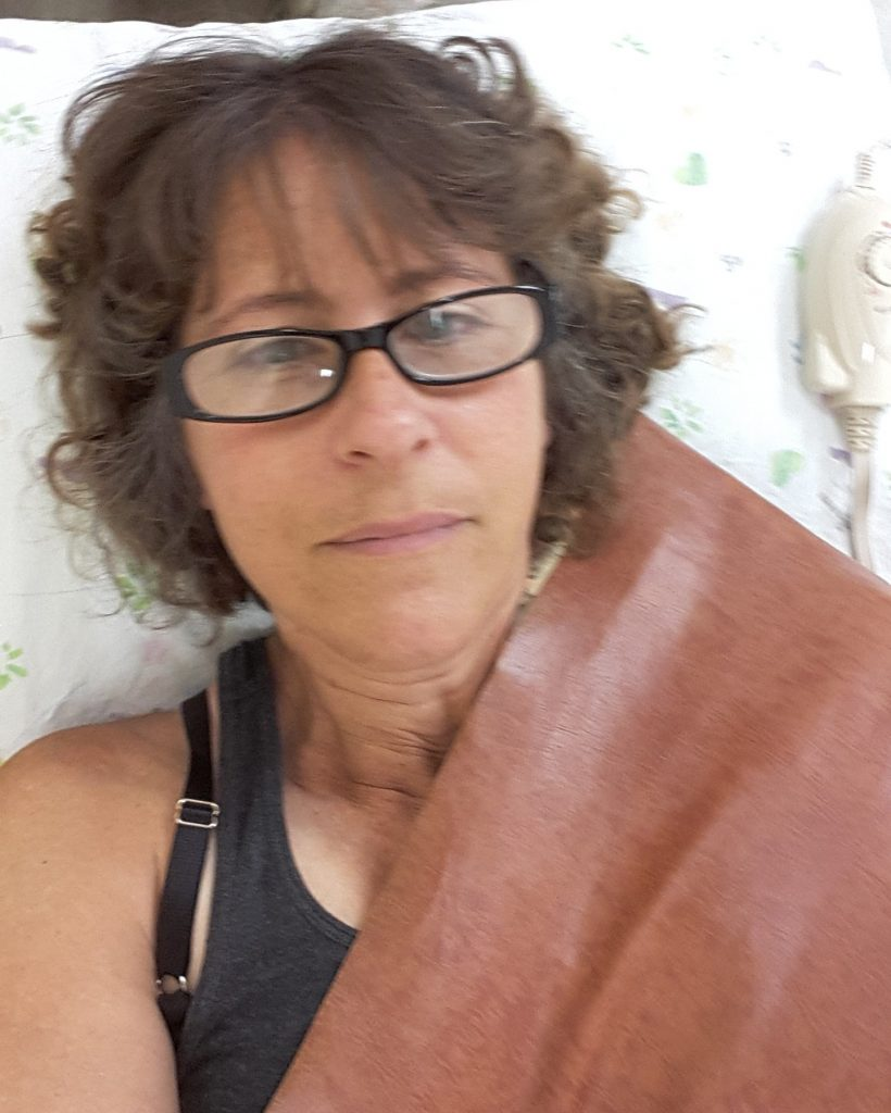Me, wrapped in a heating pad. I apologize for the general blurriness of these pictures. Its hard to take a good selfie lying down, only using your non-dominant hand.
