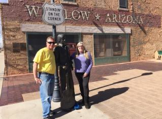 Betsy and Pete Wuebker, standing on the corner in Winslow, Arizona