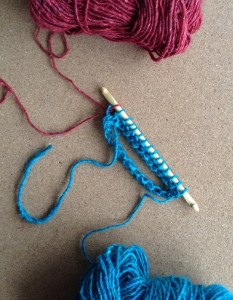 First pull yarn through one loop to start the Return pass.