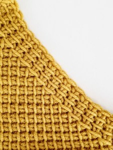Decrease: 2 Tunisian simple stitches together
