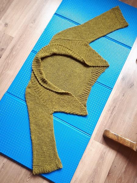 Tunisian crochet shrug on blocking board