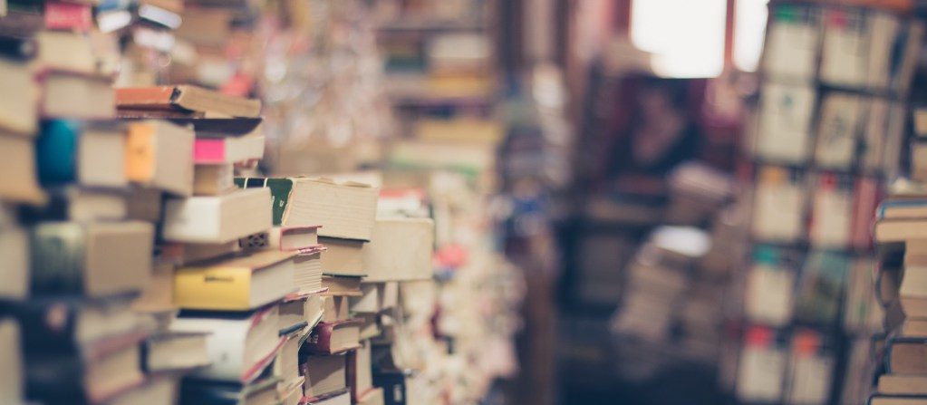 paperback books piled up