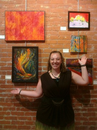 """The artist at The Elements Exhibition with her pieces, """"Windfire"""" and """"It Happens When the Wind Changes"""""""