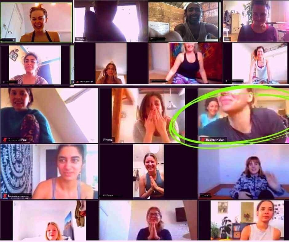A screen shot of a zoom online yoga class
