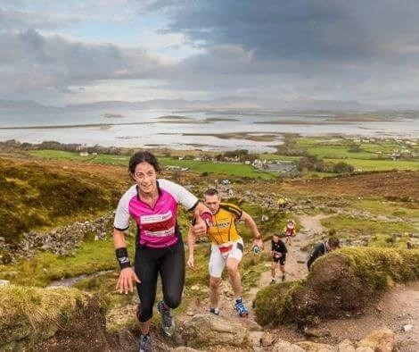 Rachel running a race up Croagh Patrick - top 10 trail routes hiking and trail running in Ireland