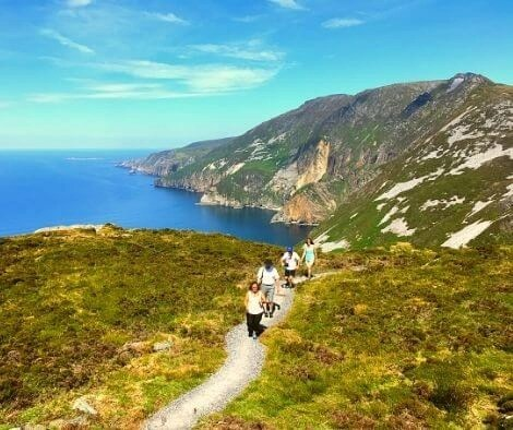 Hikers on Slieve League - top 10 trail routes hiking and trail running in Ireland