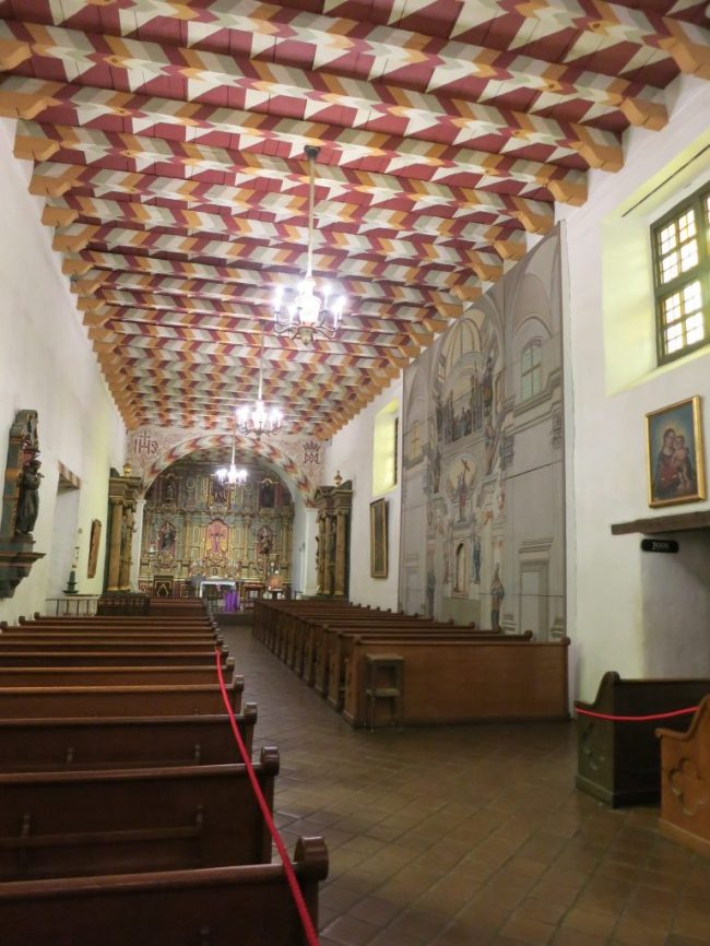 view of the interior of Mission Dolores with painted ceiling