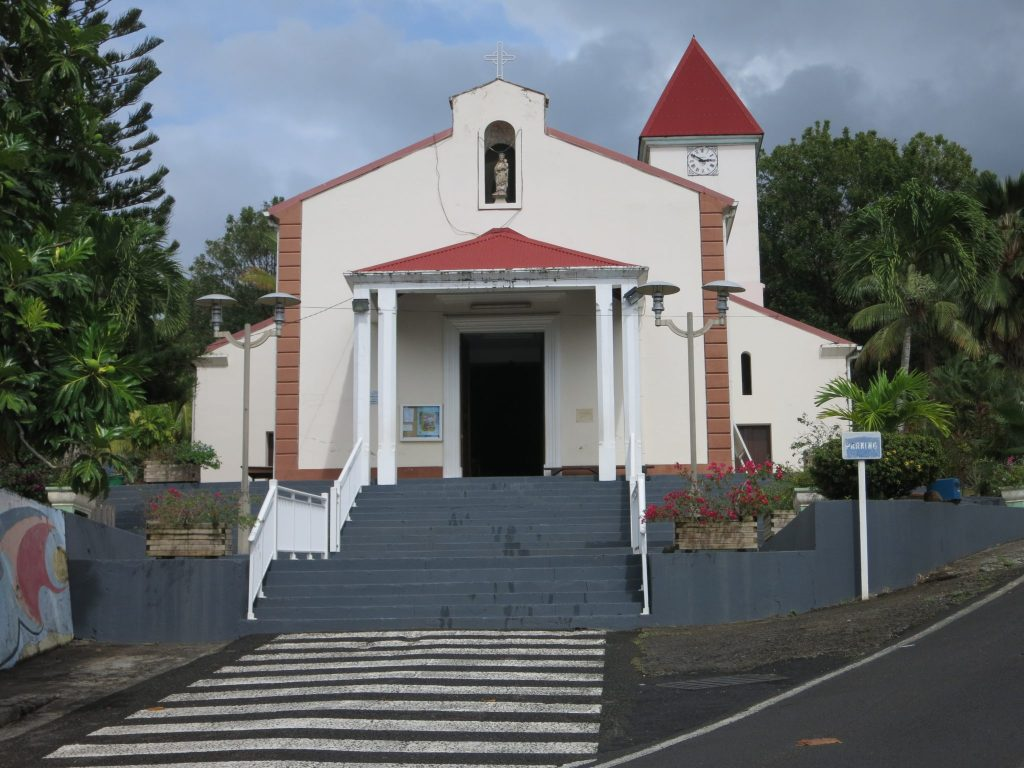 """a view of the church in Deshaies, visible in many scenes in """"Death in Paradise."""""""