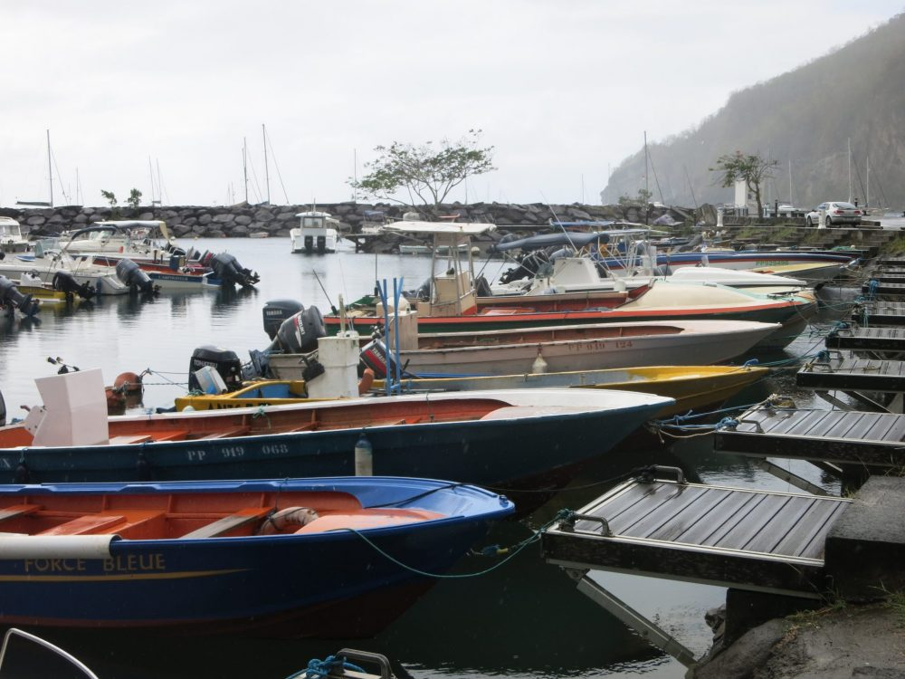 fishing boats moored in Deshaies, where Death in Paradise is filmed