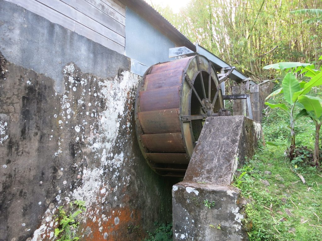 The coffee mill at Vanibel coffee plantation and its water wheel.