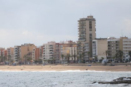view of Lloret de Mar with a row of apartments and hotels on the beach