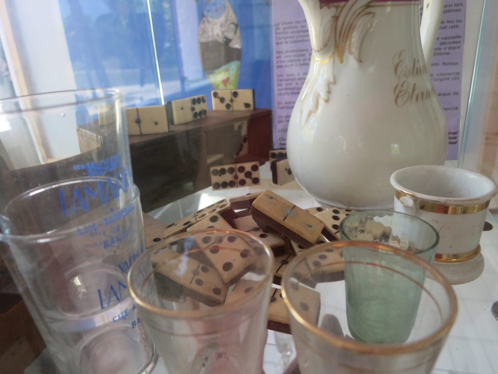 dominoes, glasses and other small items from the colonial period on display at Kreol West Indies