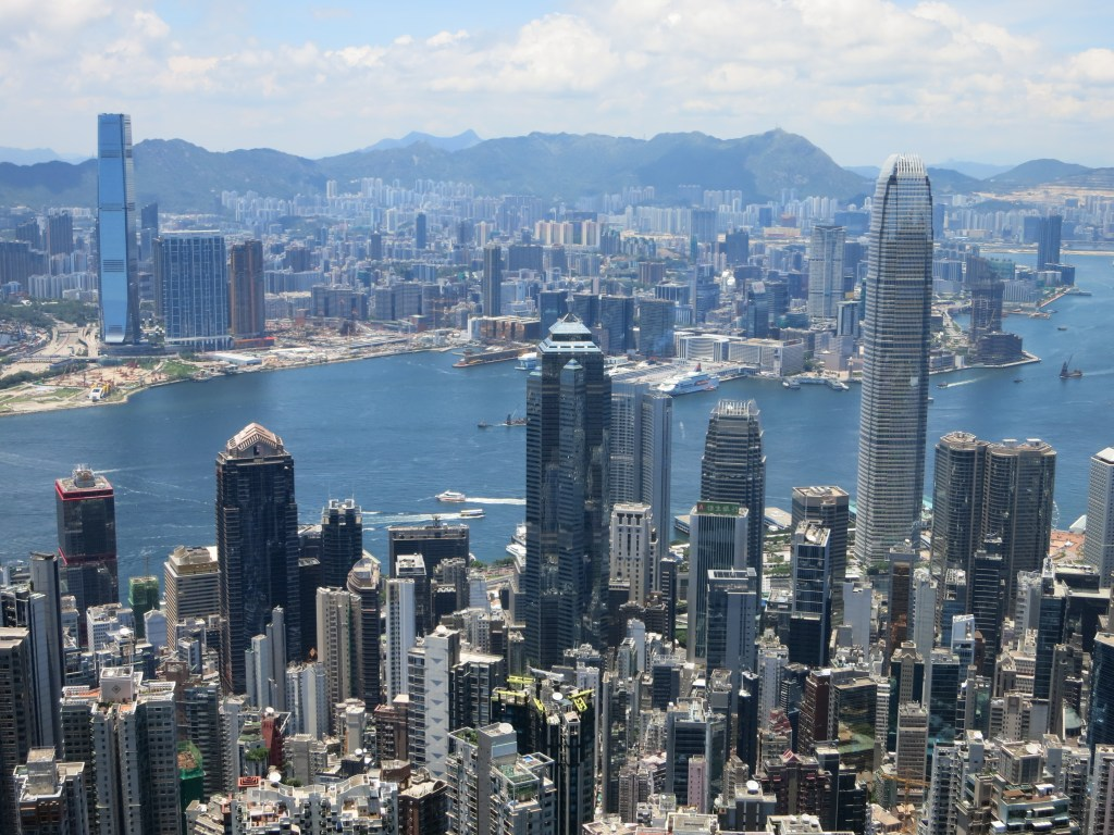 the skyscrapers of Hong Kong and Kowloon and the waterway between them, seen from Victoria Peak