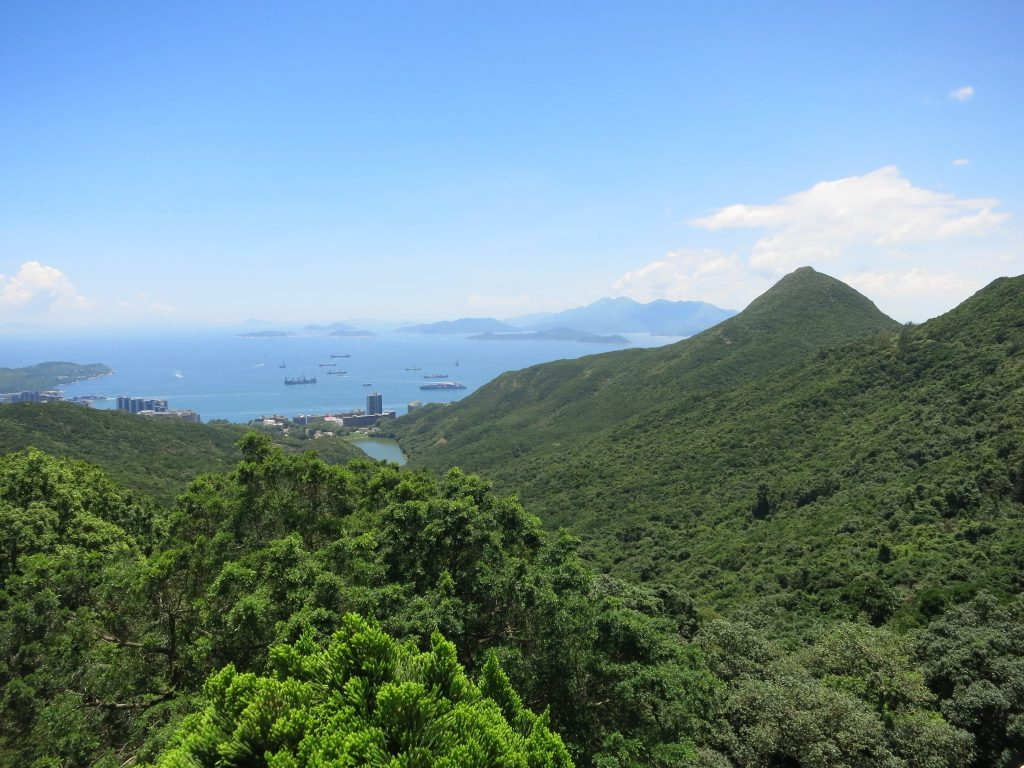 forest-covered hills with the sea in the background, as seen from the Circle Path on Victoria Peak