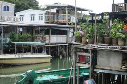 scene of jumbled houses, with boats moored outside them, in Tai O