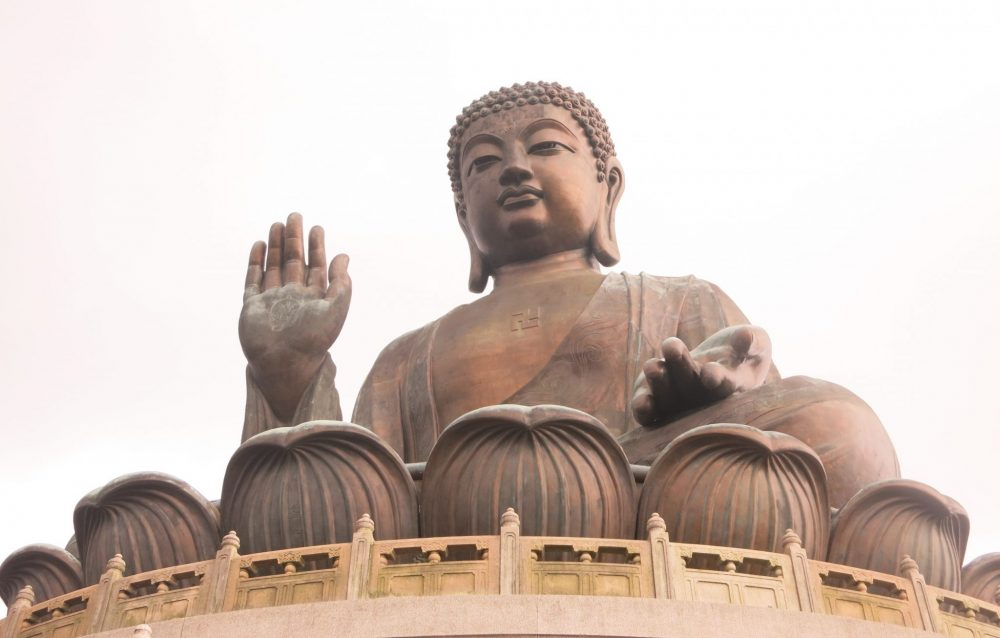 The Big Buddha sits cross-legged inside the petals of a lotus, his right hand raised. This photo was taken from below the statue.