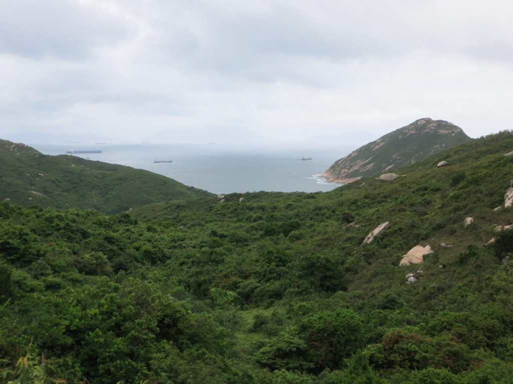 a view over green hills and sea, on Lamma Island