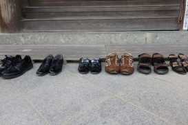 shoes lined up outside a temple in Himeji, Japan
