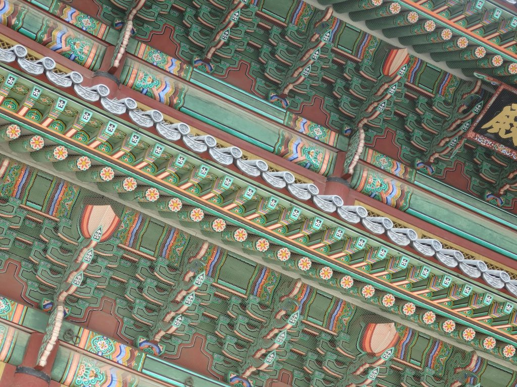 the eaves of many of the Changdeokgung Palace buildings in Seoul, Korea, are painted in very fine detail with decorative patterns.
