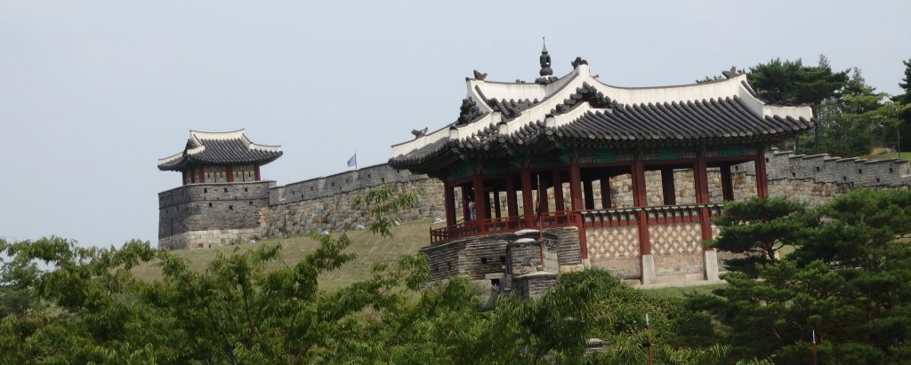 a portion of the Hwaseong Fortress wall, with two of the gates visible, in Suwon, South Korea