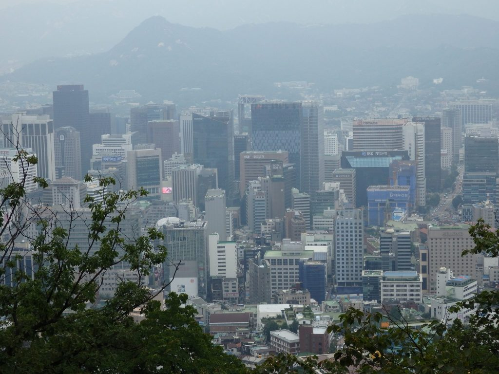 a hazy view of Seoul from the base of Seoul Tower