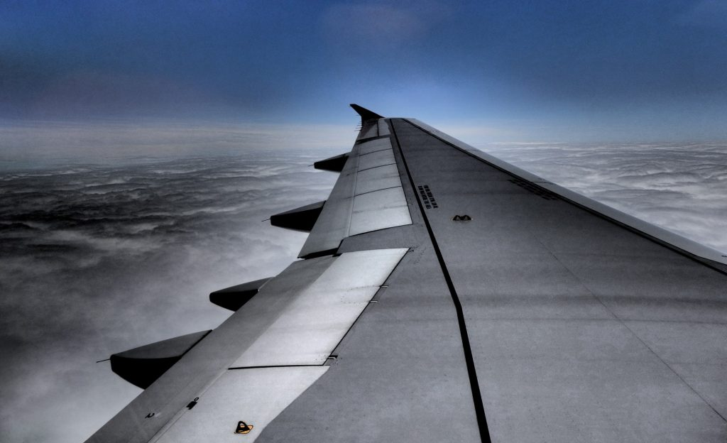 wing view of a flight at cruising altitude