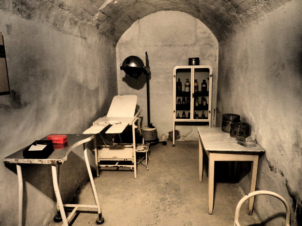 """One of the """"rooms"""" is furnished as a clinic in the Refugio de Cervantes Bomb Shelter Museum."""