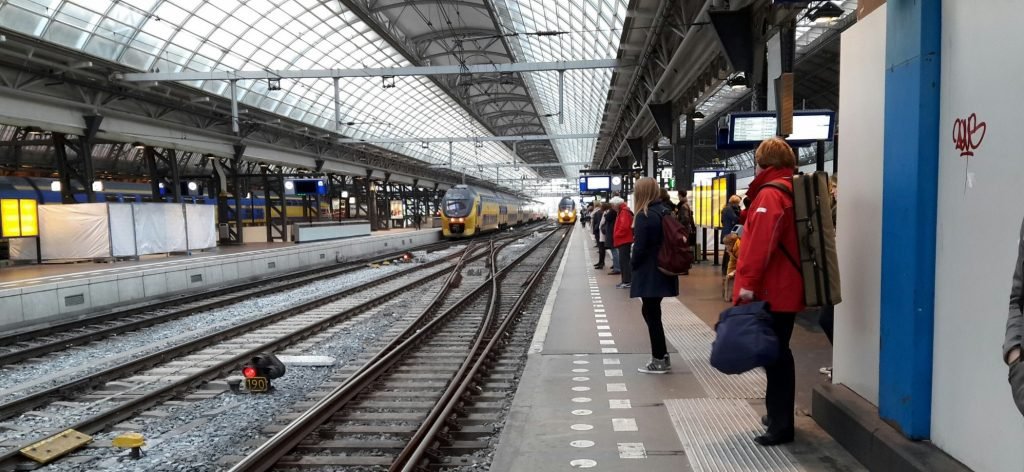 waiting for the train in Amsterdam Central Station