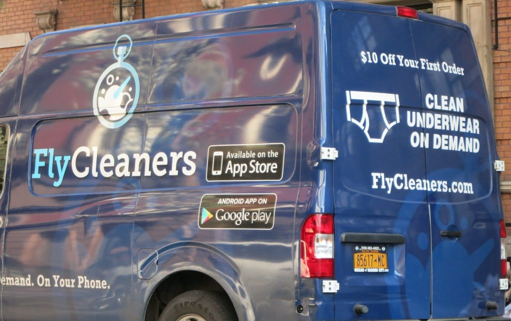 """a van with the text """"FlyCleaners"""" and """"Clean Underwear on Demand"""" in New York City"""