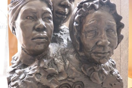 """This artwork in the lobby, called """"Unearthed"""" and created by Frank Bender, lends a face to the people buried in the African Burial Ground."""