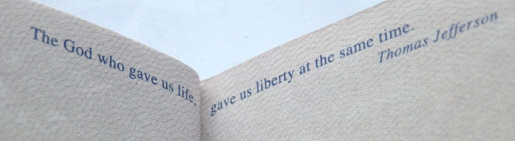 """Text from a US passport: """"The God who gave us life, gave us liberty at the same time"""" Thomas Jefferson"""
