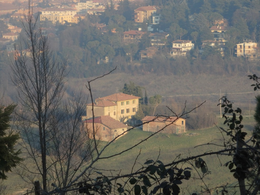 a farmhouse on the edge of Bologna, seen from the walk up to San Luca