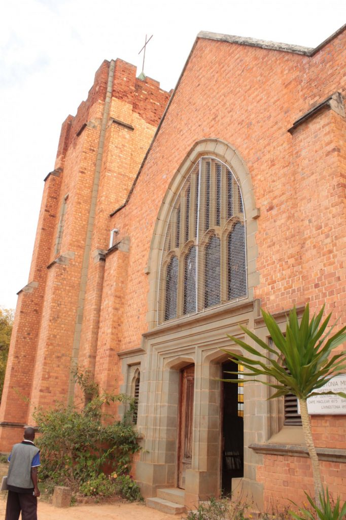 The photo shows just the front of LIvingstonia church: red brick, with an arched stained glass window above the entrance.