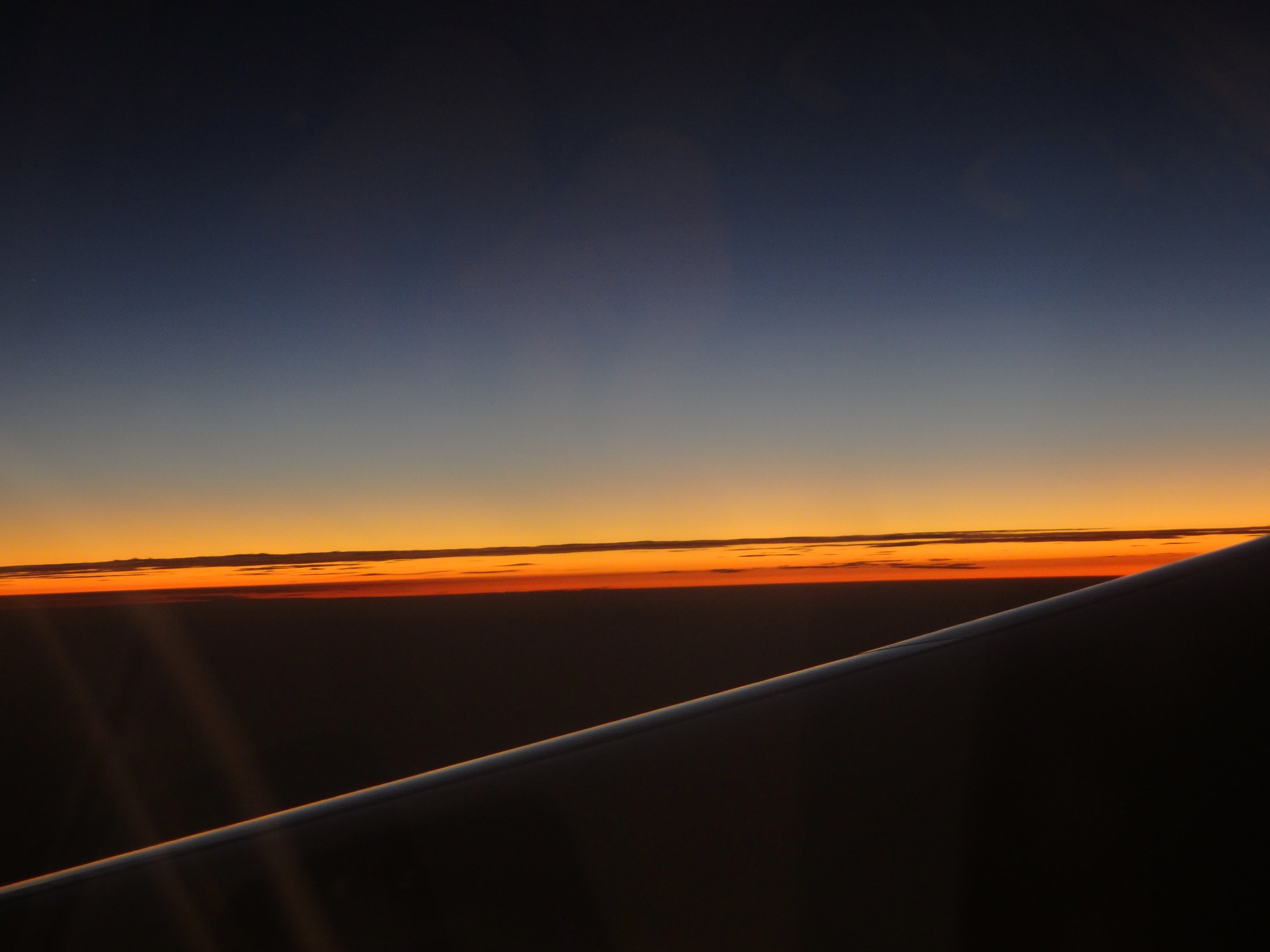 sunset as a pilot and passengers might see it from a plane