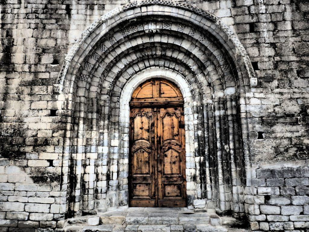 entrance archway to the Santa Maria church in Arties, Val d'Aran, Spain