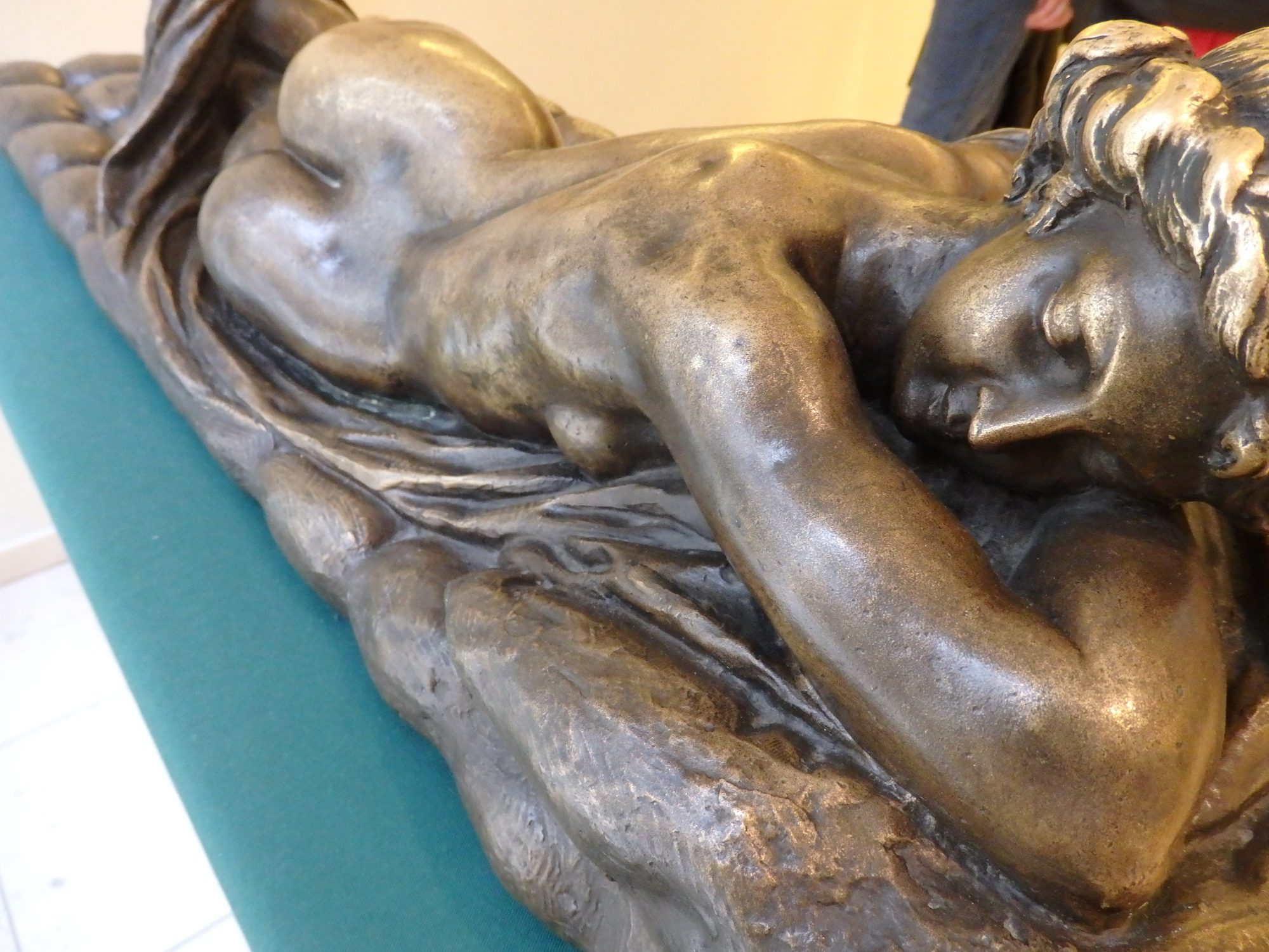 In the room with the pornographic photo collection, this bronze statue of Hermaphroditos is helpfully explained on an information panel. In the Sex Museum, Amsterdam.