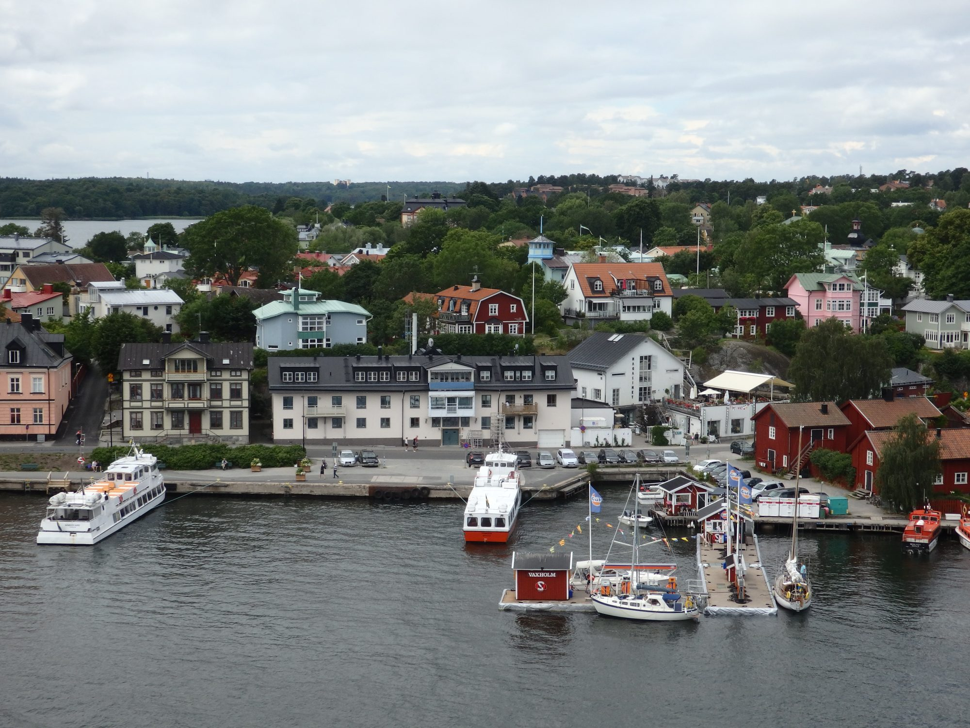 the small town across a narrow channel from Vaxholm, as seen from Vaxholm's tower roof