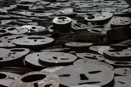 metal faces on the floor of the memory void in the Jewish museum Berlin