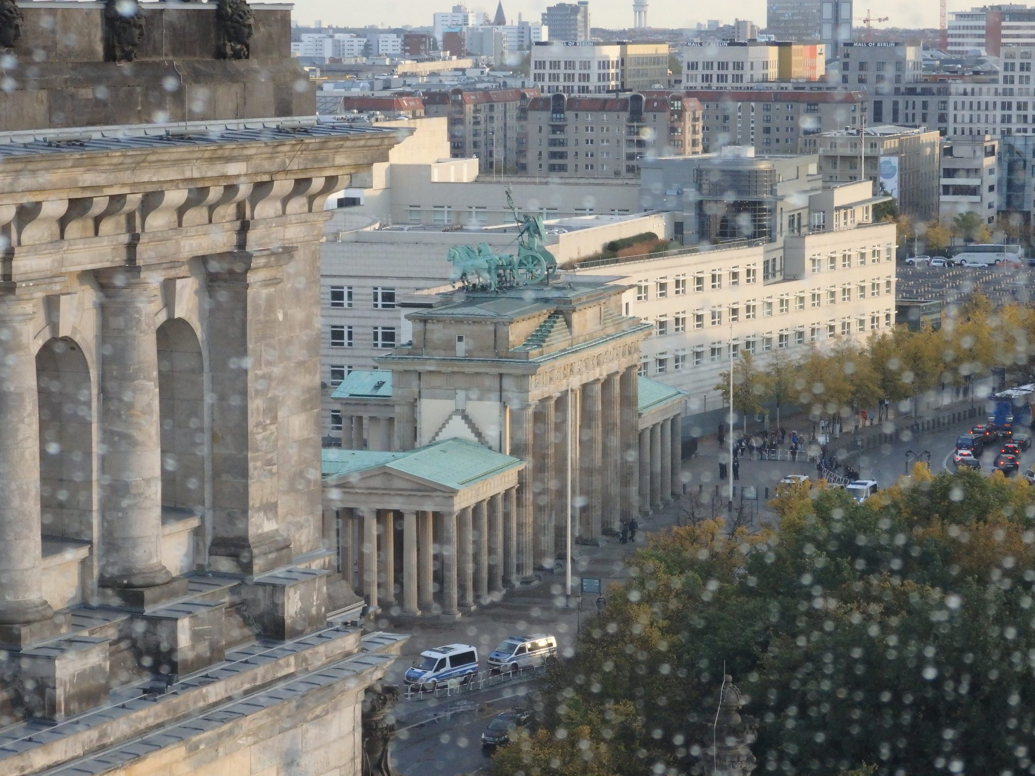 This picture shows the famous Brandenburg Gate. Built in the late 18th century, it was meant to represent peace. During the Cold War it was on East German territory and inaccessible to both East and West Germans. The white building just beyond it is the new US Embassy.