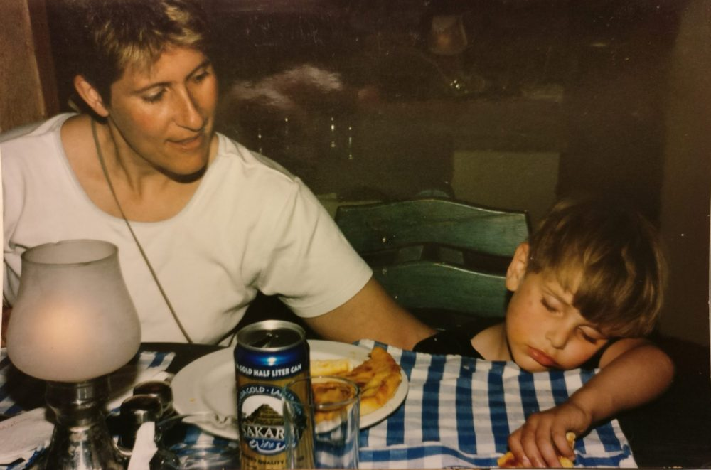 This snapshot shows how our son, who was about four years old at the time, was so exhausted from a day of beaching in Egypt that he fell asleep clutching a piece of pizza.