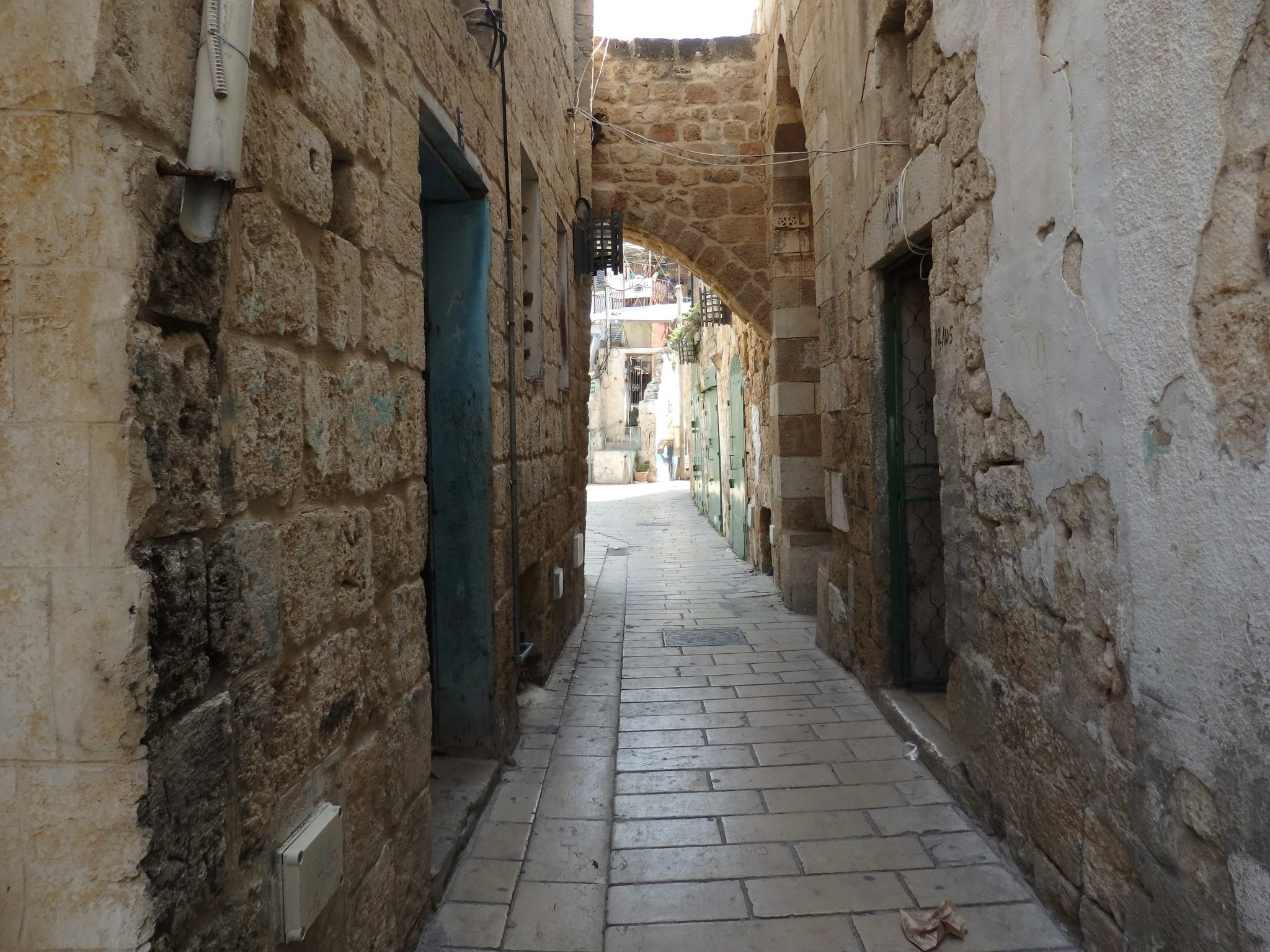 A narrow street in Akko old city shows remnants of its history.