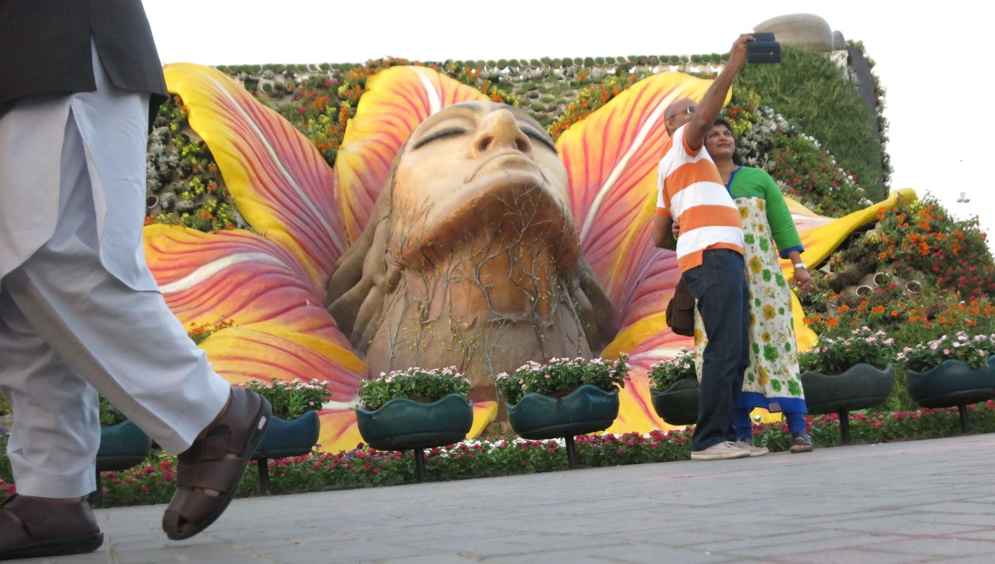 A giant male head seems to emerge from a flower in Dubai Miracle Garden.