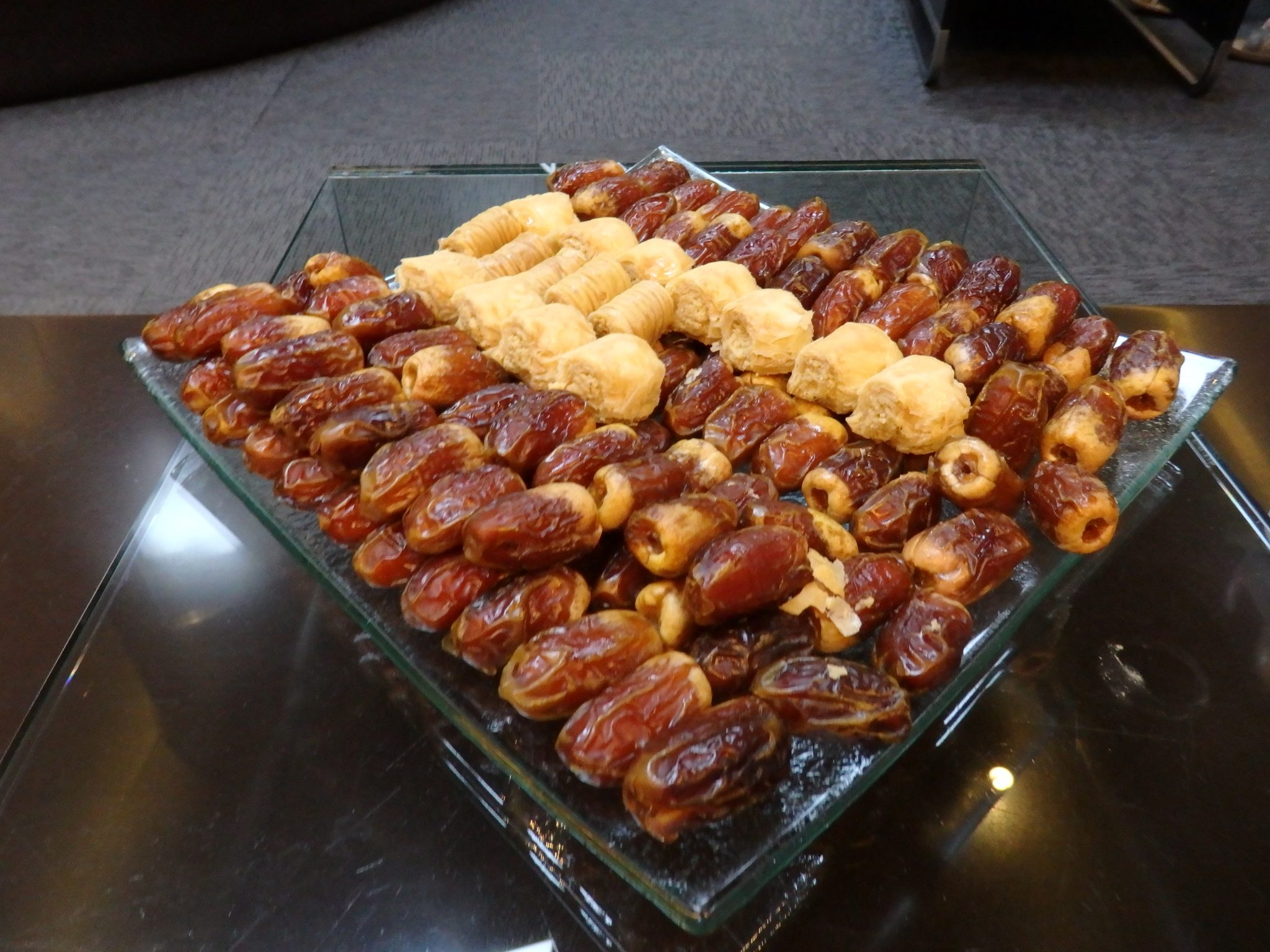 """A tray of dates and Arabic sweets in the """"lounge"""" where we waited."""
