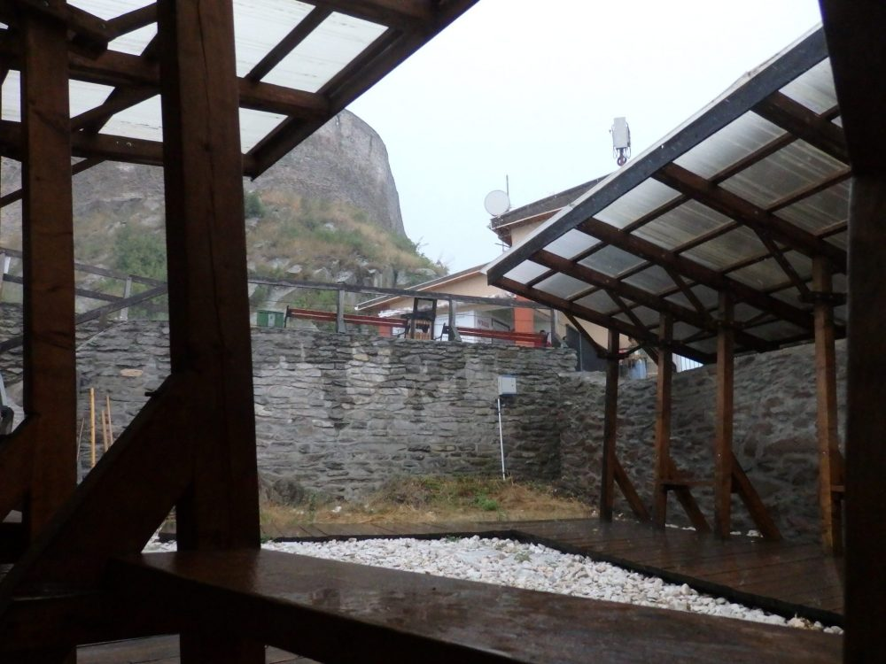 My view from where I sat on the ground between the stone wall and a wooden bench. You can see a bit of the cable car station in the background, and the wall of Deva Castle above.