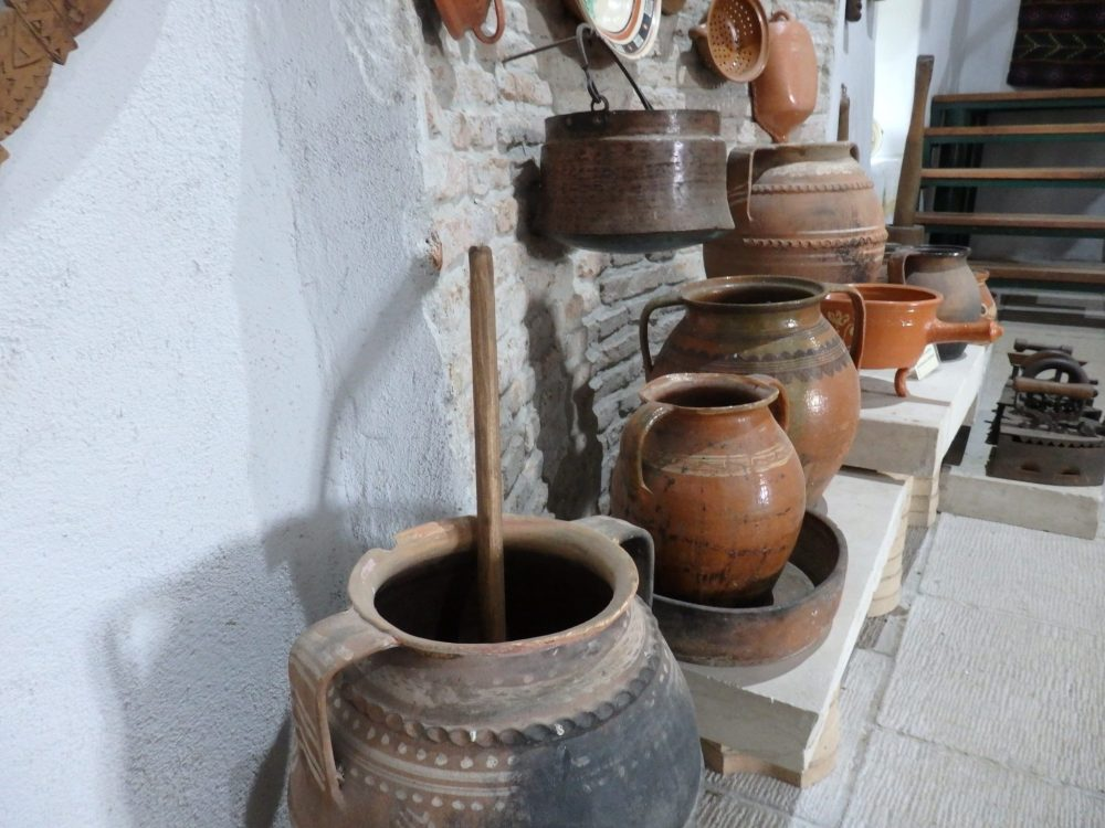 A display of household objects in the museum at Calnic fortified church