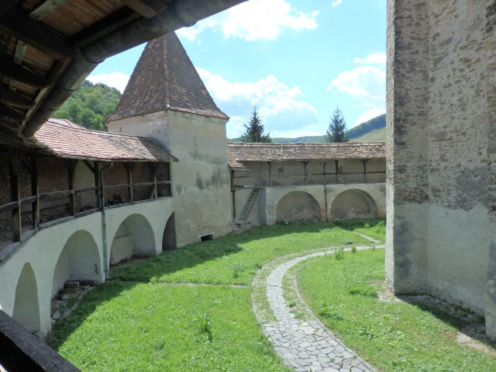 The defensive walls at Valea Viilor fortified church, with one of the guard towers.