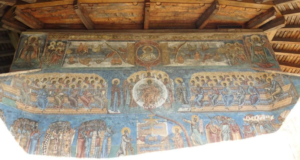 The top half of an entire wall dedicated to the Last Judgement. The bottom half was in full sunlight, so I couldn't get a picture of the whole thing. It's amazing that the colors have lasted so well. The Spectacular Painted Churches of Moldavia.