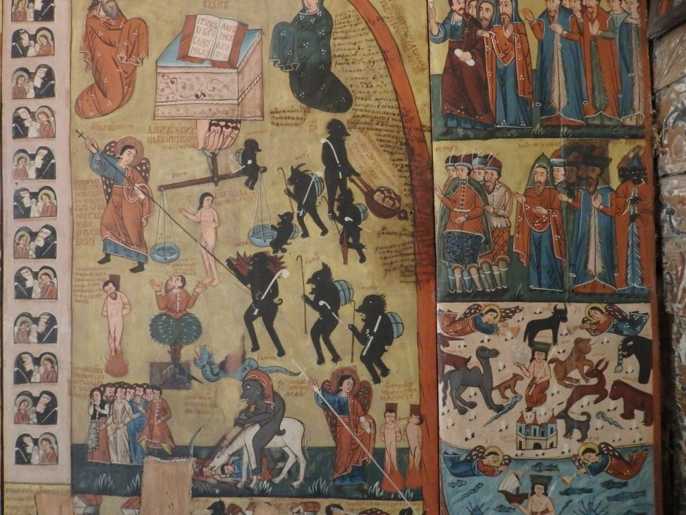 This fresco depicting the Day of Judgment in Budesti's church doesn't leave much to the imagination. Wooden Churches of Maramures.